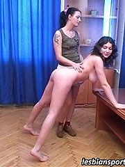 Busty beauty gets naked and trained... lesbian porn pics